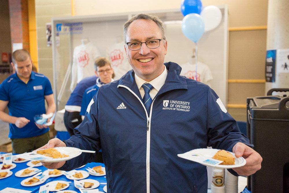 President Steven Murphy holding pie