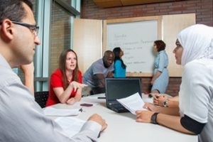 Faculty staff having a meeting in a meeting room