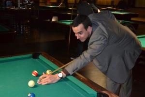Alumni playing pool