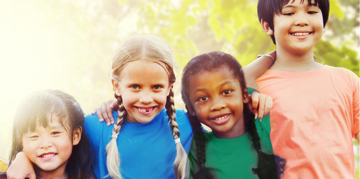 Children hugging and smiling