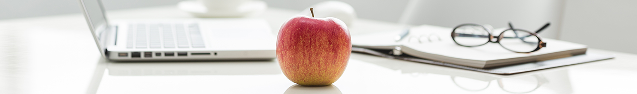 wellness header with apple and eye glasses