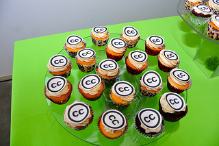 A platter of cupcakes with Creative Commons logo decoration.