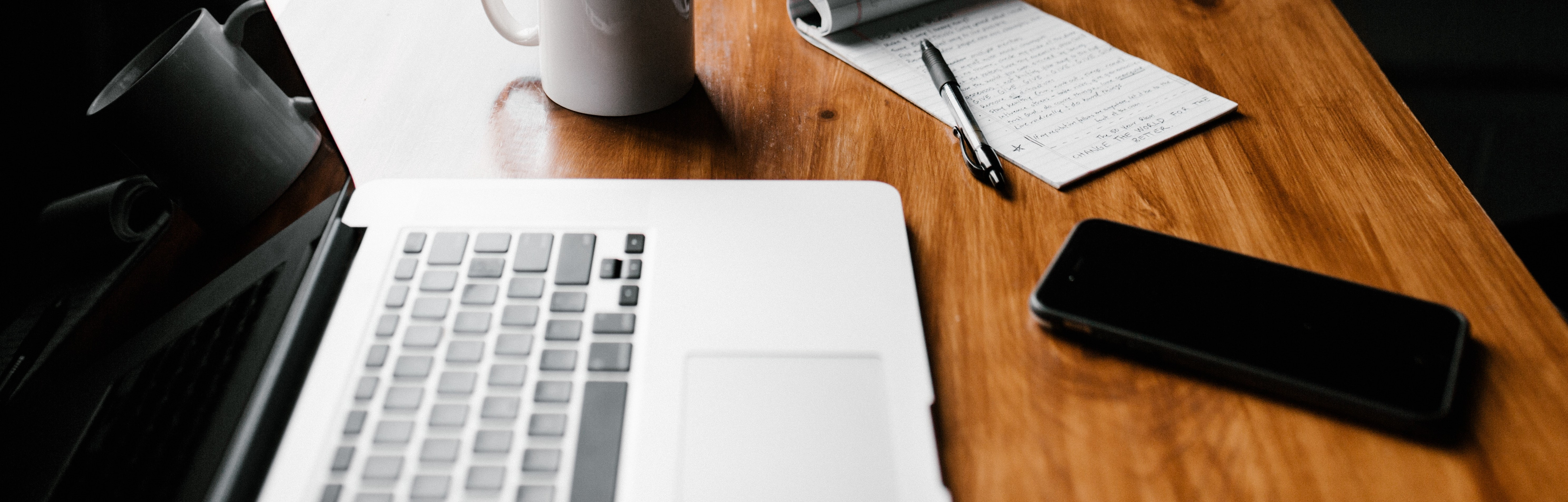 Photo by Andrew Neel on Unsplash. A coffee mug and laptop on a table