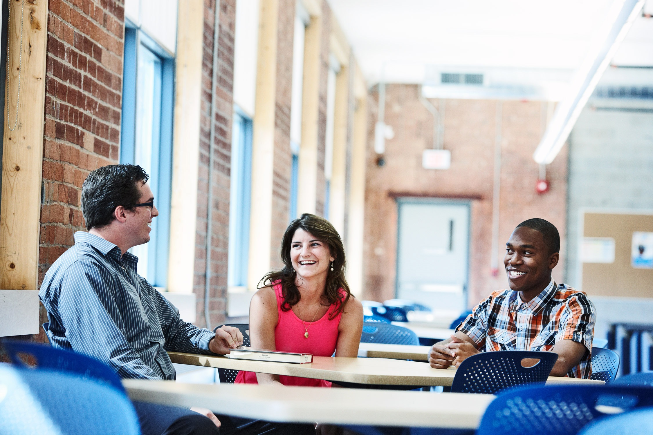 students conversing around a table