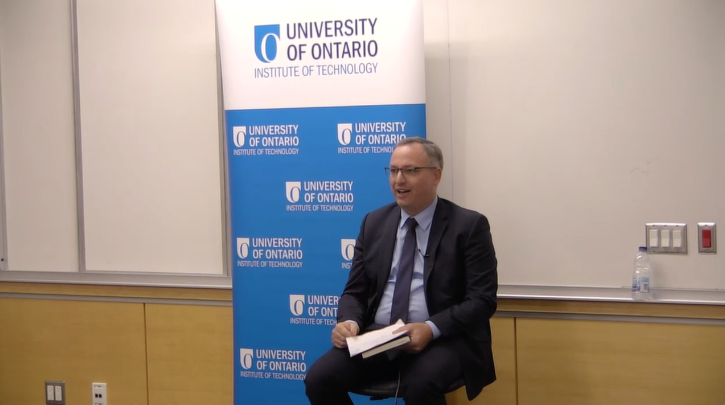"""Dr. Steven Murphy speaking in a lecture room for the """"ONTechU Discussions with President Steven"""" event"""