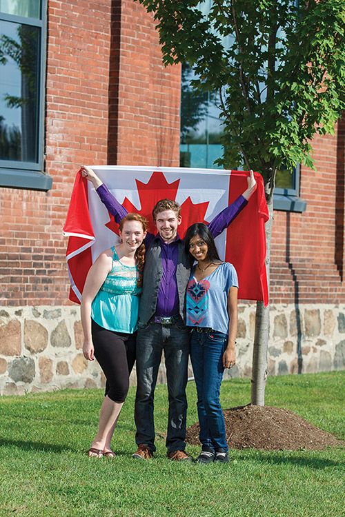 Students with Canadian flag