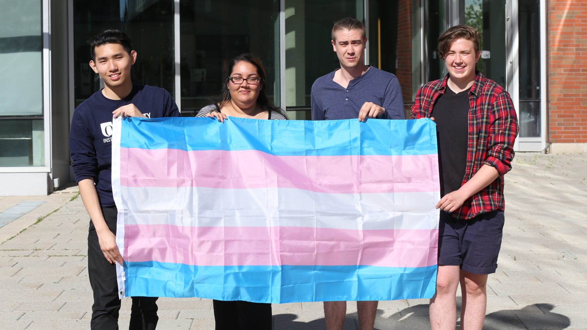 students with trans flag