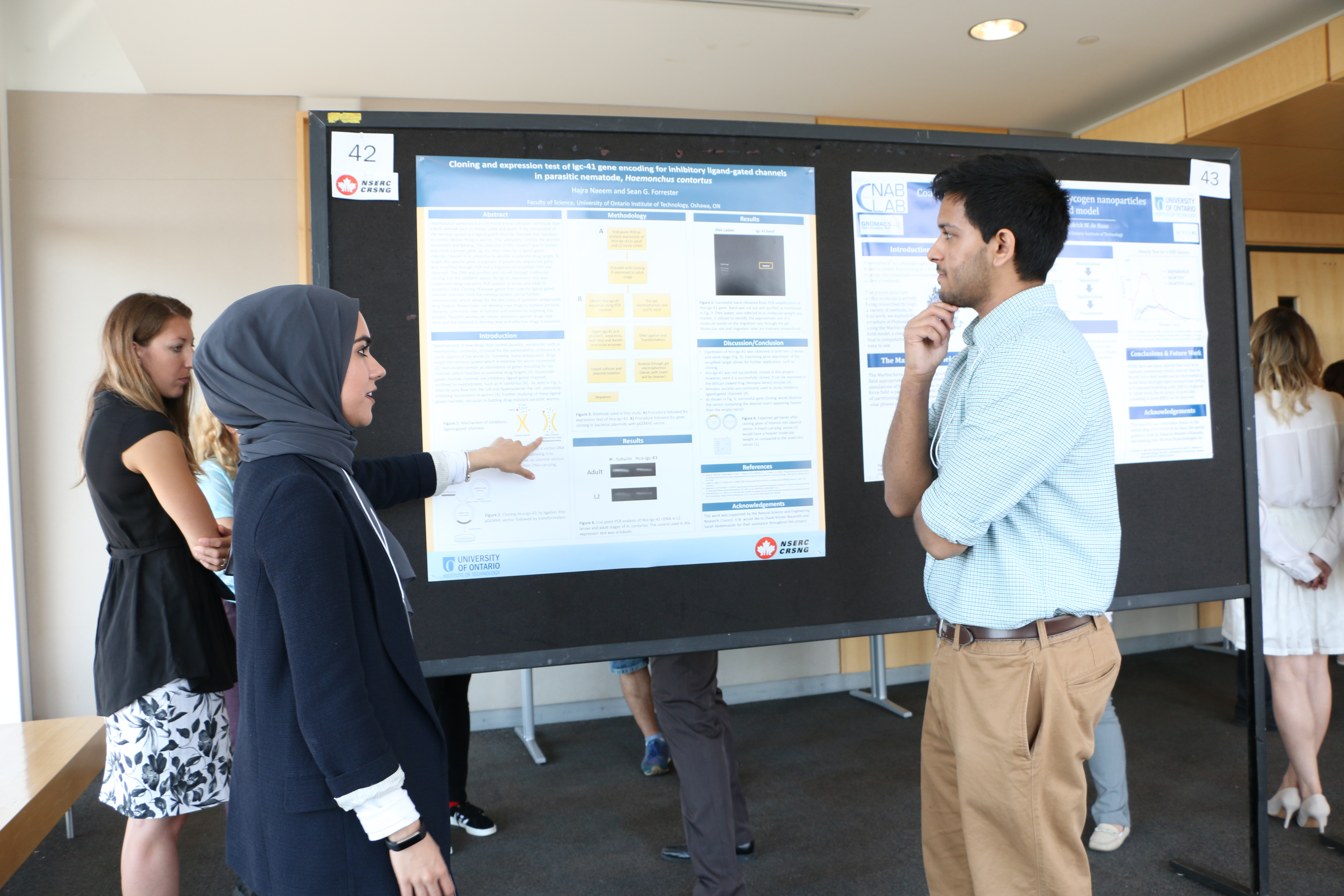 student presenting poster for research competition