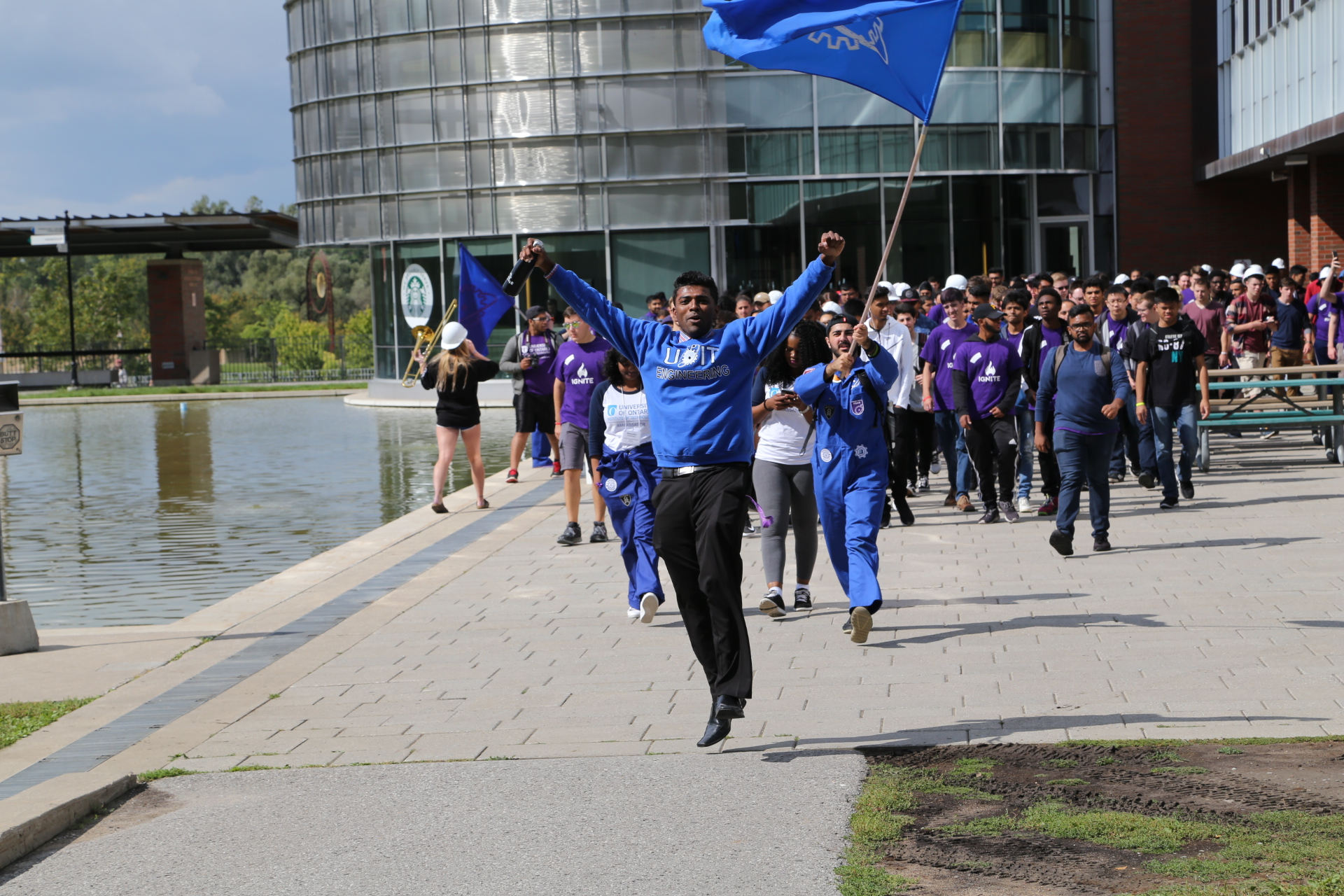 engsoc running with flags at orientation