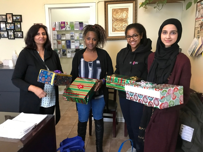 Lubna (right), Ereeb (taking the picture), and I (second from right) donated care packages that were wrapped by our general members.