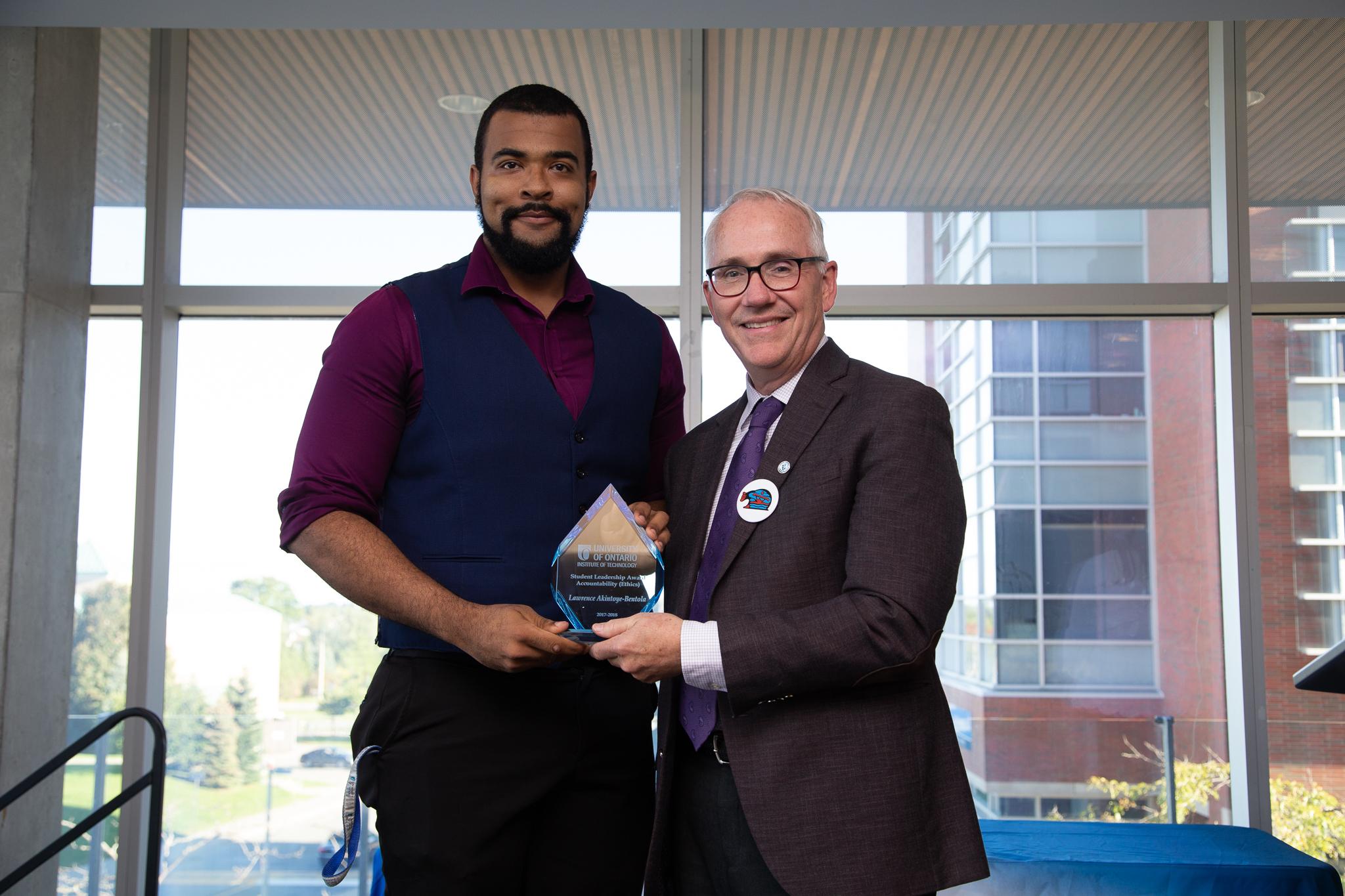 Lawrence getting award