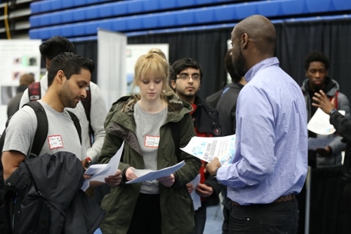Students talking with company representative at the university job fair