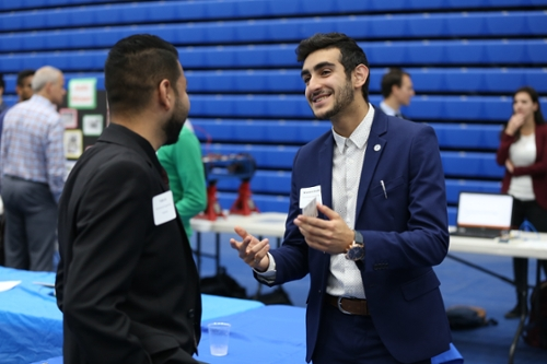 Student speaking with a company representative at the university job fair