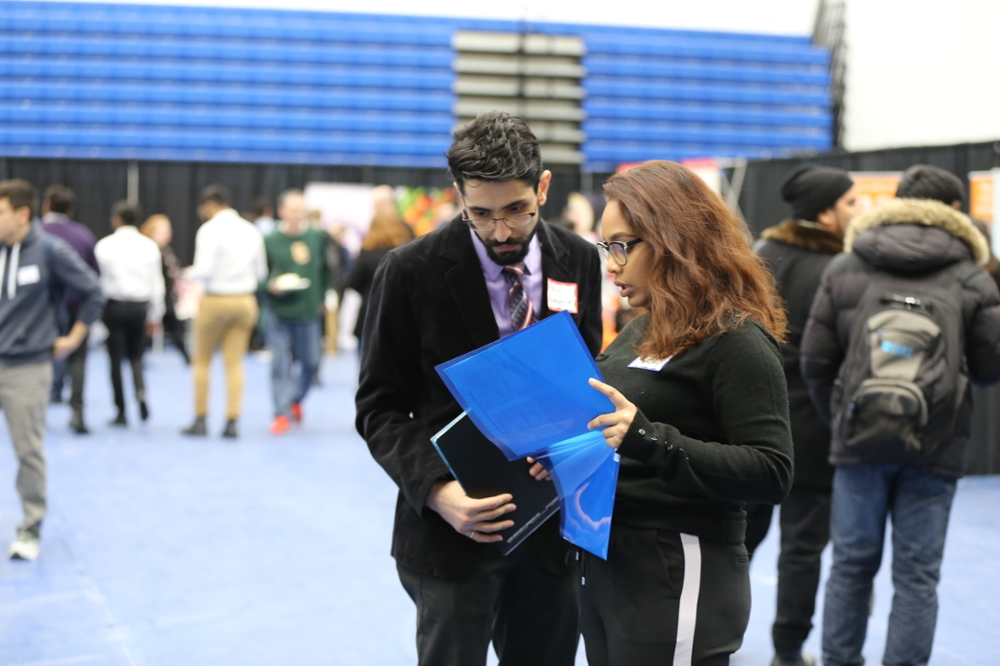 Student talking with company representative at the university job fair