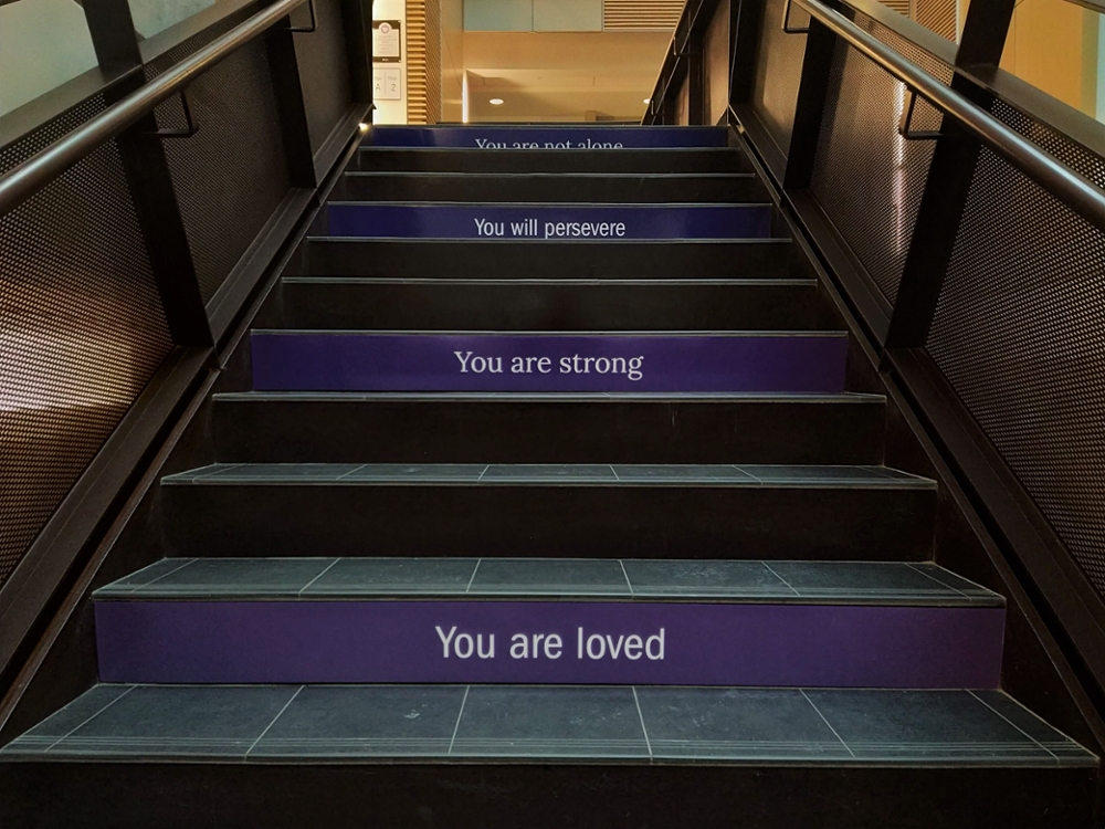 """Stairs that say """"You are loved"""", """"You are strong"""" and """"You will preserve"""""""