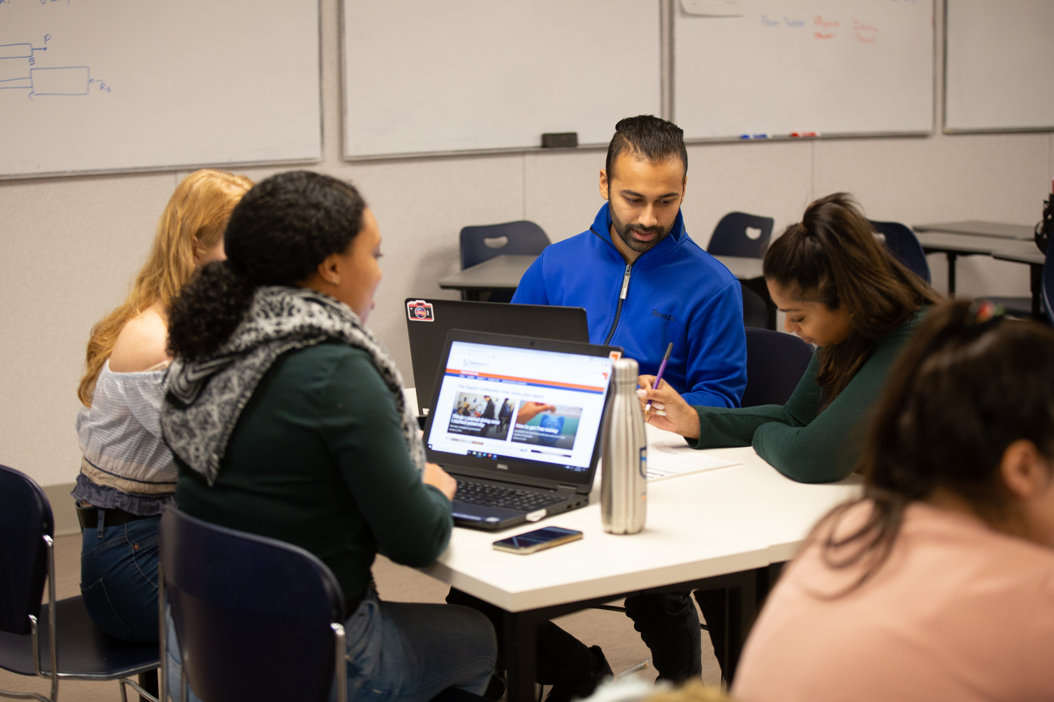 Four students sitting at a table working together.