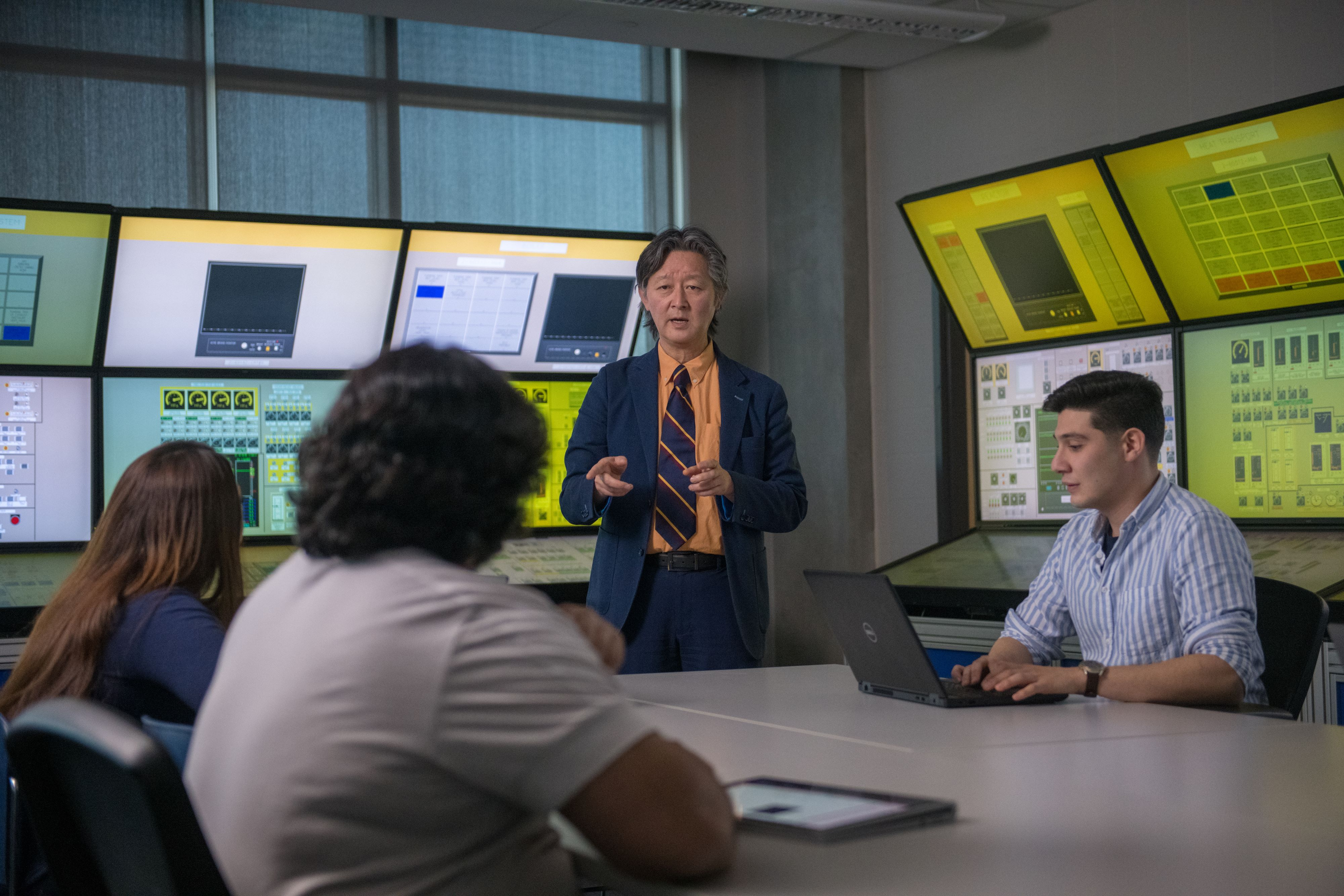 Dr. Akira Tokuhiro (speaking), Dean, Faculty of Energy Systems and Nuclear Science, Ontario Tech University.