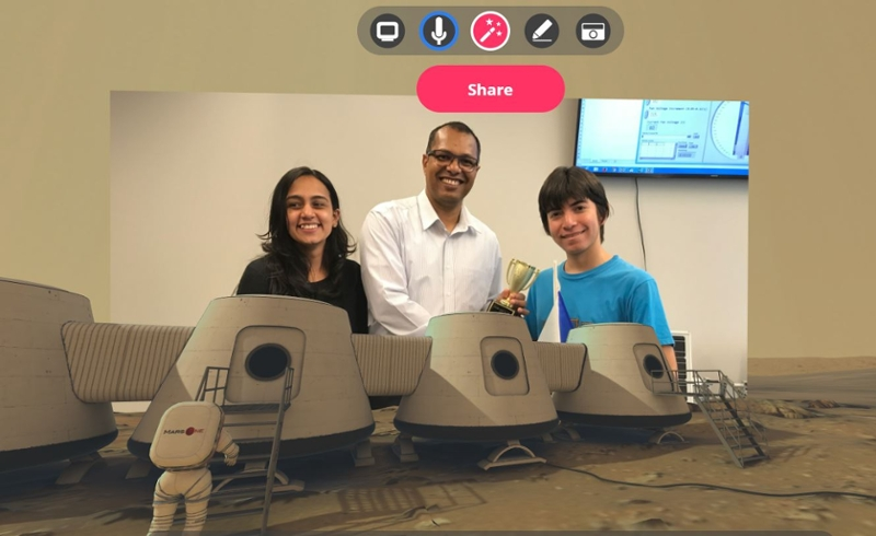 Mars virtual reality background: Sharman Perera, Associate Teaching Professor and Laboratory Manager, Faculty of Energy Systems and Nuclear Science (FESNS, centre) presents an award in the FESNS Wind Chamber Lab to high school students from Jamaica's Hillel Academy for winning a 2019 FESNS design competition. The students were visiting Ontario Tech University as a part of the International Enrichment program conducted by Ontario Tech's Office of the Registrar.