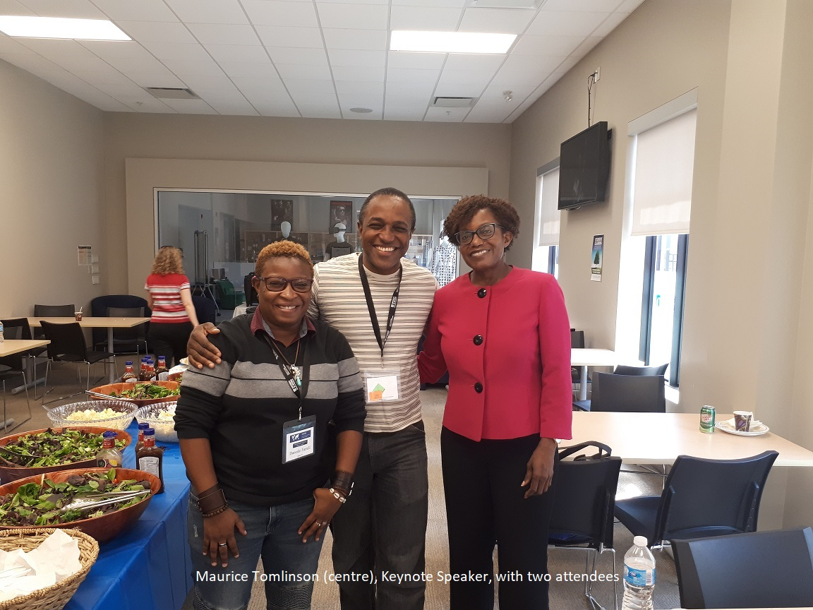 Maurice Tomlinson, one of the keynote speakers, pictured with conference attendees. ${altNumber}
