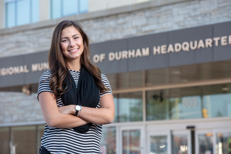 Practicum Student, Alyssa Shaver, in front of the regional municipality of Durham headquarter