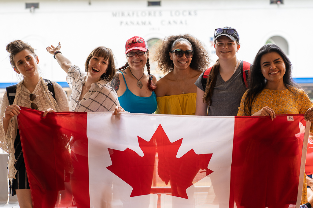 Students holding a large Canadian flag