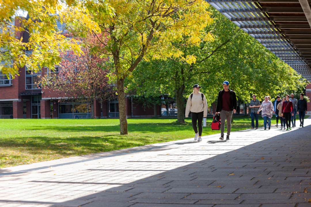 Students walking in Polonsky Commons in spring