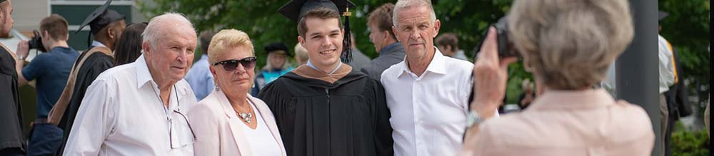 Photo of graduate and guests, Text: Information for guests